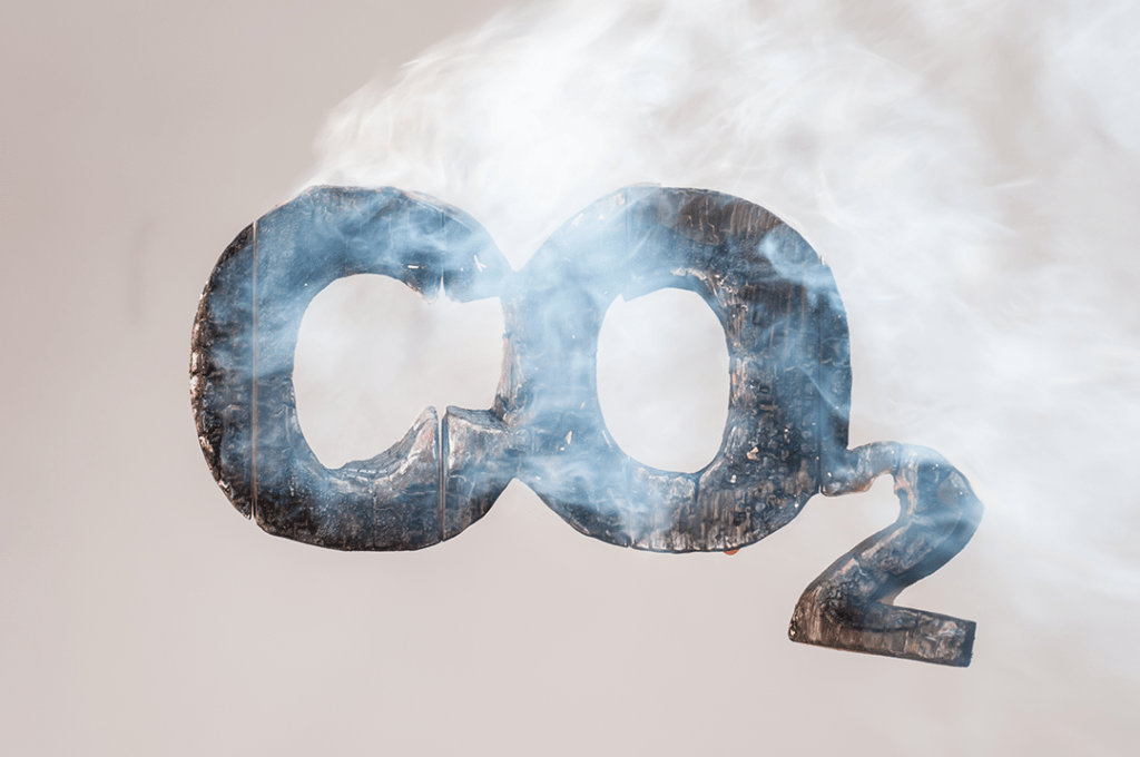 An image of a burning, smoking representation of CO2, one of the greenhouse gases that contribute to climate change.
