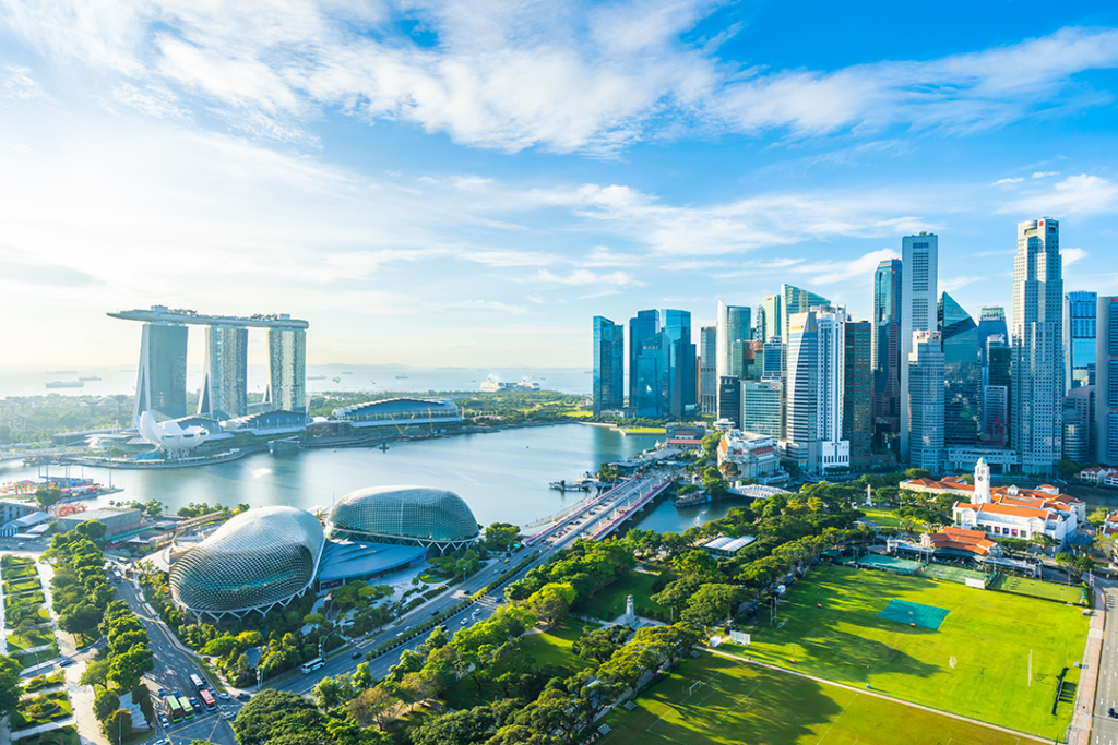 A photo of Singapore's skyline, featuring green spaces and modern architecture as the city-state implements the Singapore Green Plan 2030.
